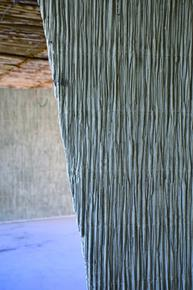 The exposed concrete surfaces of the walls of the Lycée Marc Bloch in the district of Sérignan in southern France look as if they incorporate bundles of reeds. The look of this form of construction was revived by the architect François Fontes.